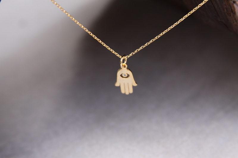 tiny gold hamsa necklace