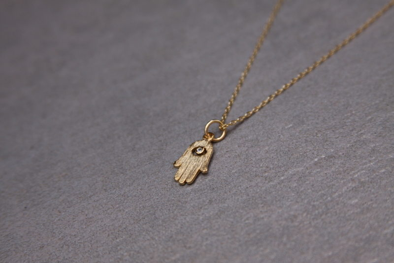 tiny gold hamsa necklace
