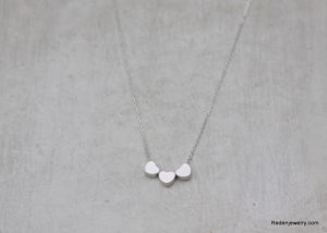 three silver hearts necklace