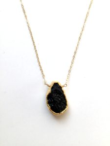 gold plated black lava bead necklace