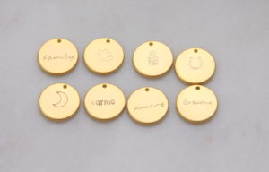 hand stamped gold charms by Reija Eden